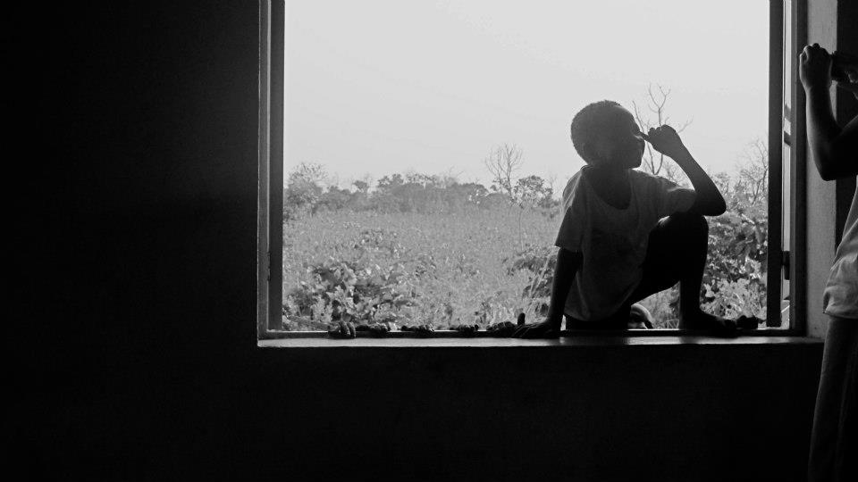 African boy in window b&w