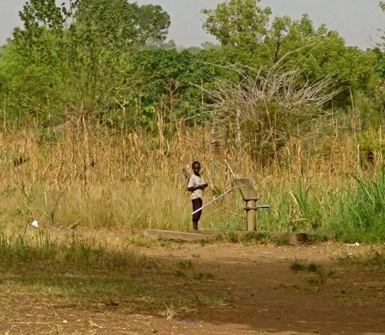 African boy at neverthirst well CROPPED