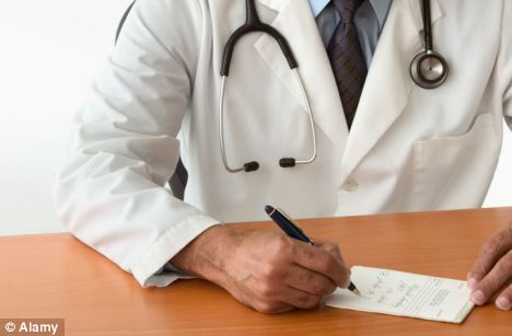 Doctor writing at desk