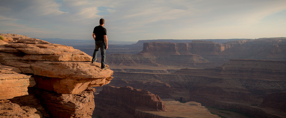 man looking over a canyon